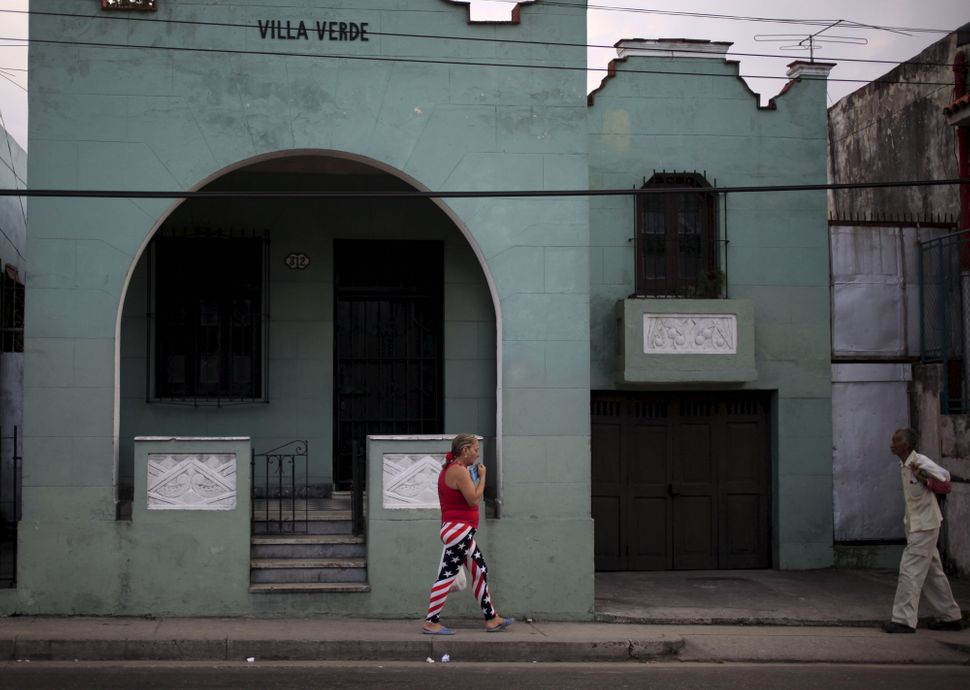 A woman in Havana wears pants with the colors of the U.S. flag.