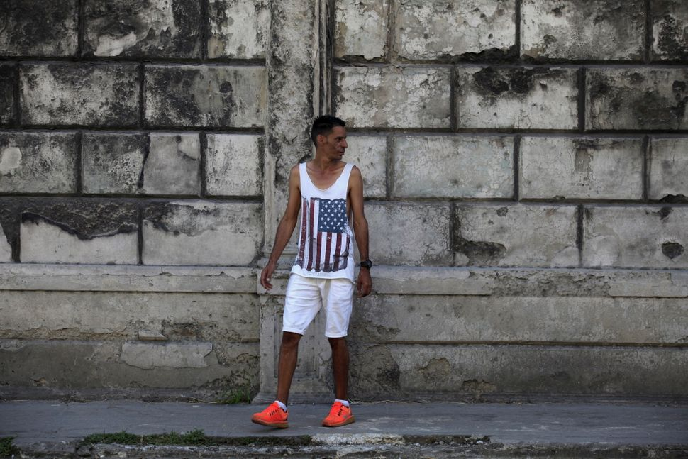 A man in Havana wears a shirt with the U.S. flag.