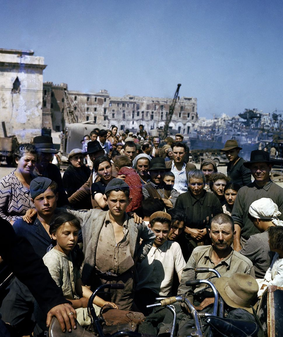 Crowds of Italians in Anzio wait to board the ships that will take them to Naples. June 1944.