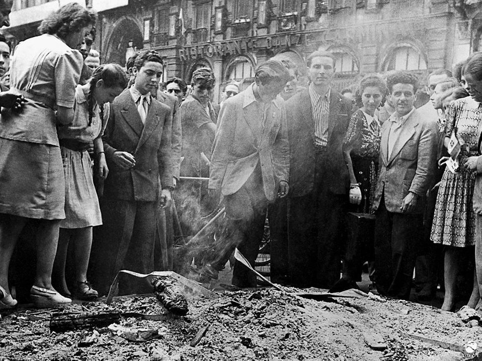 Citizens destroy fascist documents and symbols. Milan, July 26, 1943.