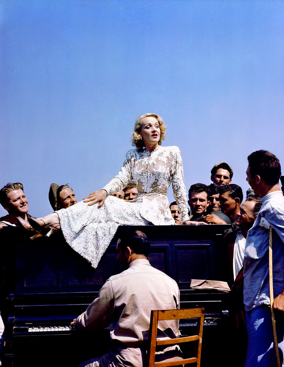 German-born singer and actress Marlene Dietrich puts on a show for wounded American soldiers at a military hospital on the It