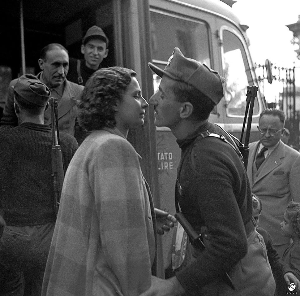 An innocent kiss before parting for the front, observed by Mussolini's Minister of Popular Culture (Propagandist) Fernan