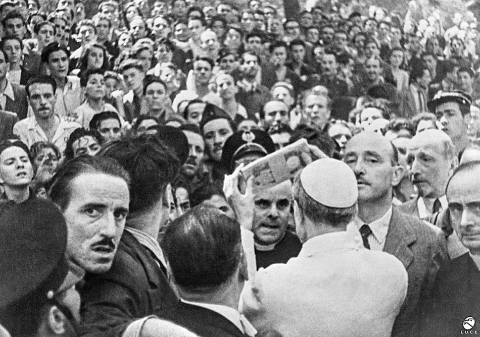 Pope Pius XII distributes financial aid in Piazza San Giovanni after the bombing of Rome. Aug. 13, 1943.