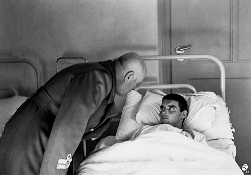 Benito Mussolini visits a wounded soldier. 1942.