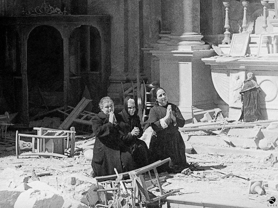 Women praying amongst the ruins of the Church of Santa Anna. Caligari, February 1943.