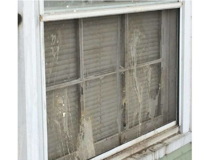 A close-up of a damaged window at the home ofAlbert Clemens Sr.