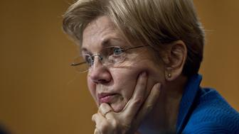 Senator Elizabeth Warren, a Democrat from Massachusetts, listens during a Senate Banking Committee hearing with Janet Yellen, chair of the U.S. Federal Reserve, not pictured, in Washington, D.C., U.S., on Thursday, Feb. 11, 2016. Yellen said the Fed was taking another look at negative interest rates as a potential policy tool if the U.S. economy faltered, a scenario some investors view as a mounting possibility amid a darkening outlook for world growth. Photographer: Andrew Harrer/Bloomberg via Getty Images