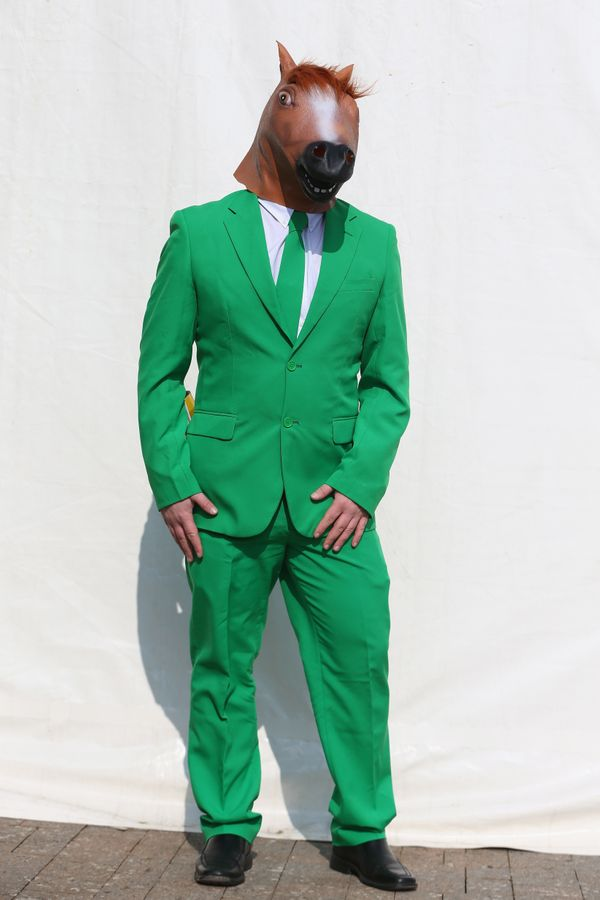 An Irish racegoer dressed for the occasion on St Patrick's Thursday at the racecourse in Cheltenham, England, on March 1