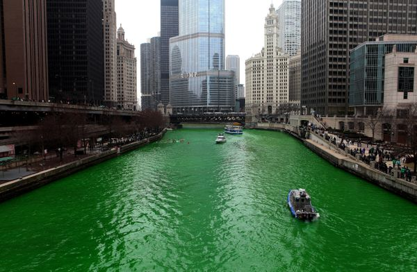 People lined along Upper and Lower Wacker Drive and the Riverwalk, after members of Plumbers Local 130 U.A. poured envir