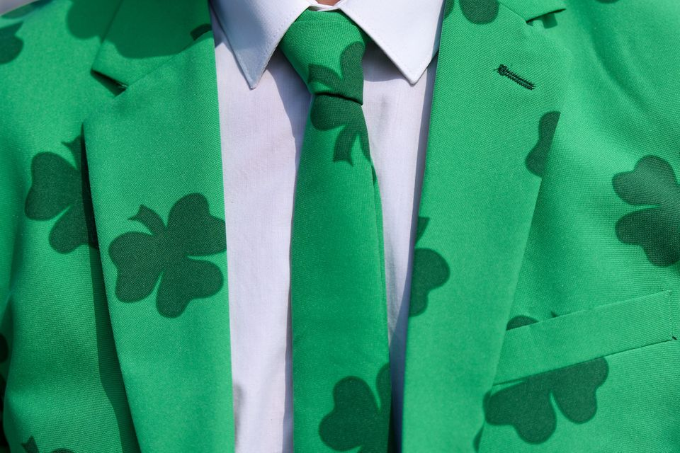 A man wears a shamrock-covered suit during St Patrick's Day at a festival at Cheltenham Racecourse in Gloucestershire, Englan