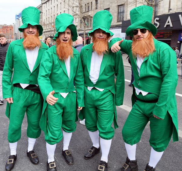 Revelers dressed as leprechauns pose for a photograph on O'Connell Street, as the largest St. Patrick's day celebrations in I