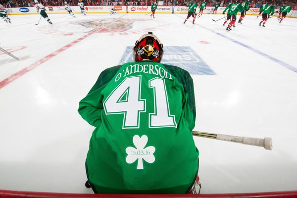 Craig Anderson #41 of the Ottawa Senators wears a green St. Patrick's Day warm up jersey during warmup before an NHL gam