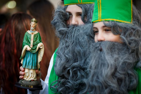 A statue of St Patrick is carried during the St Patrick's Day parade through central London on March 13, 2016 in London, Engl