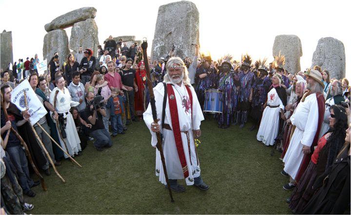 Druids celebrate the summer solstice at Stonehenge.