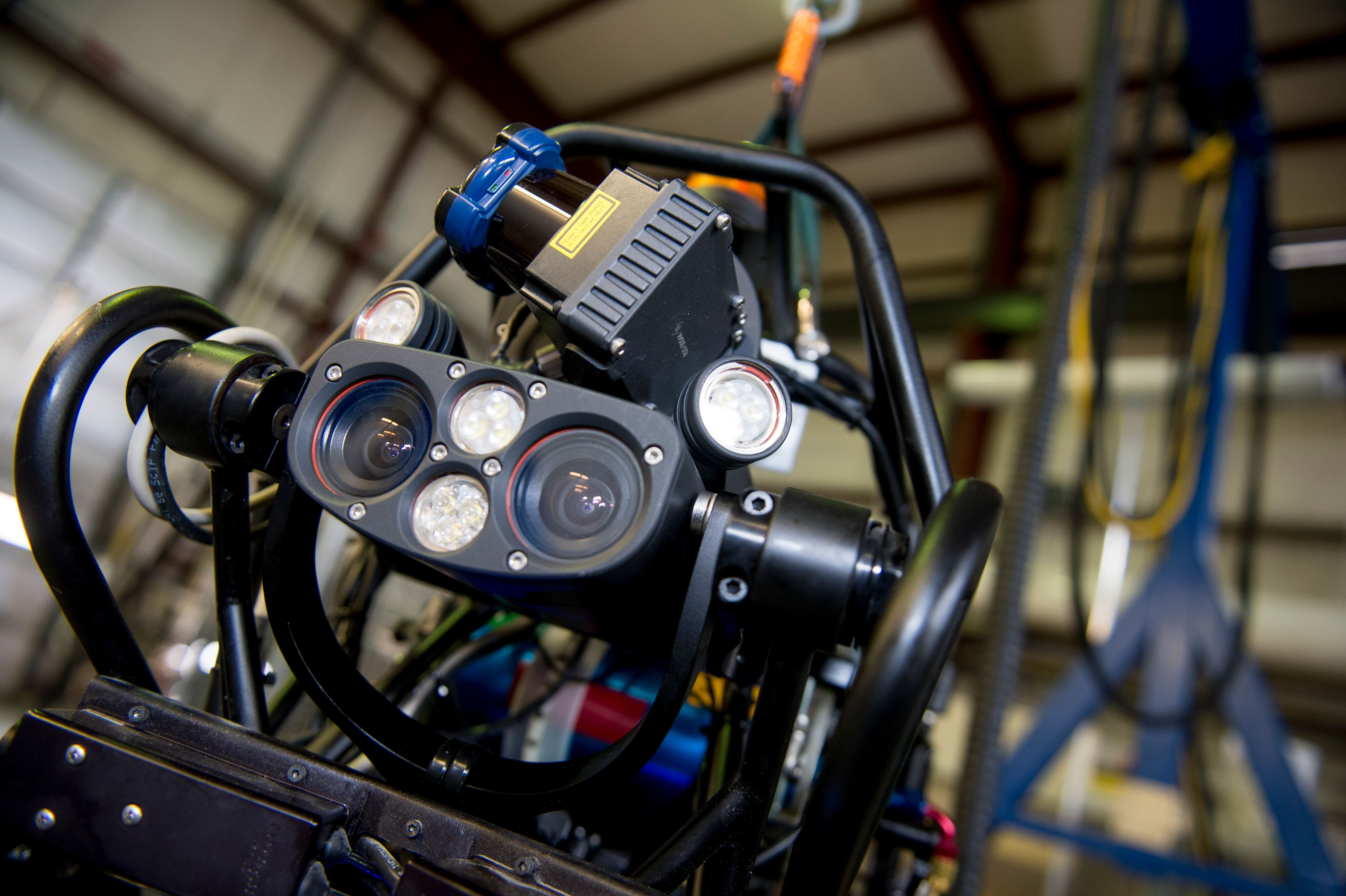 BOSTON, MA - April 7: The capabilities of the Atlas robot are demonstrated during the Massachusetts Institute of Technology's Computer Science and Artificial Intelligence Laboratory's Demo Day on April 6, 2013 in Boston, Massachusetts. The Boston Dynamics funded Atlas robot is a part of the DARPA Robotics Challenge program. (Photo by Ann Hermes/The Christian Science Monitor via Getty Images)