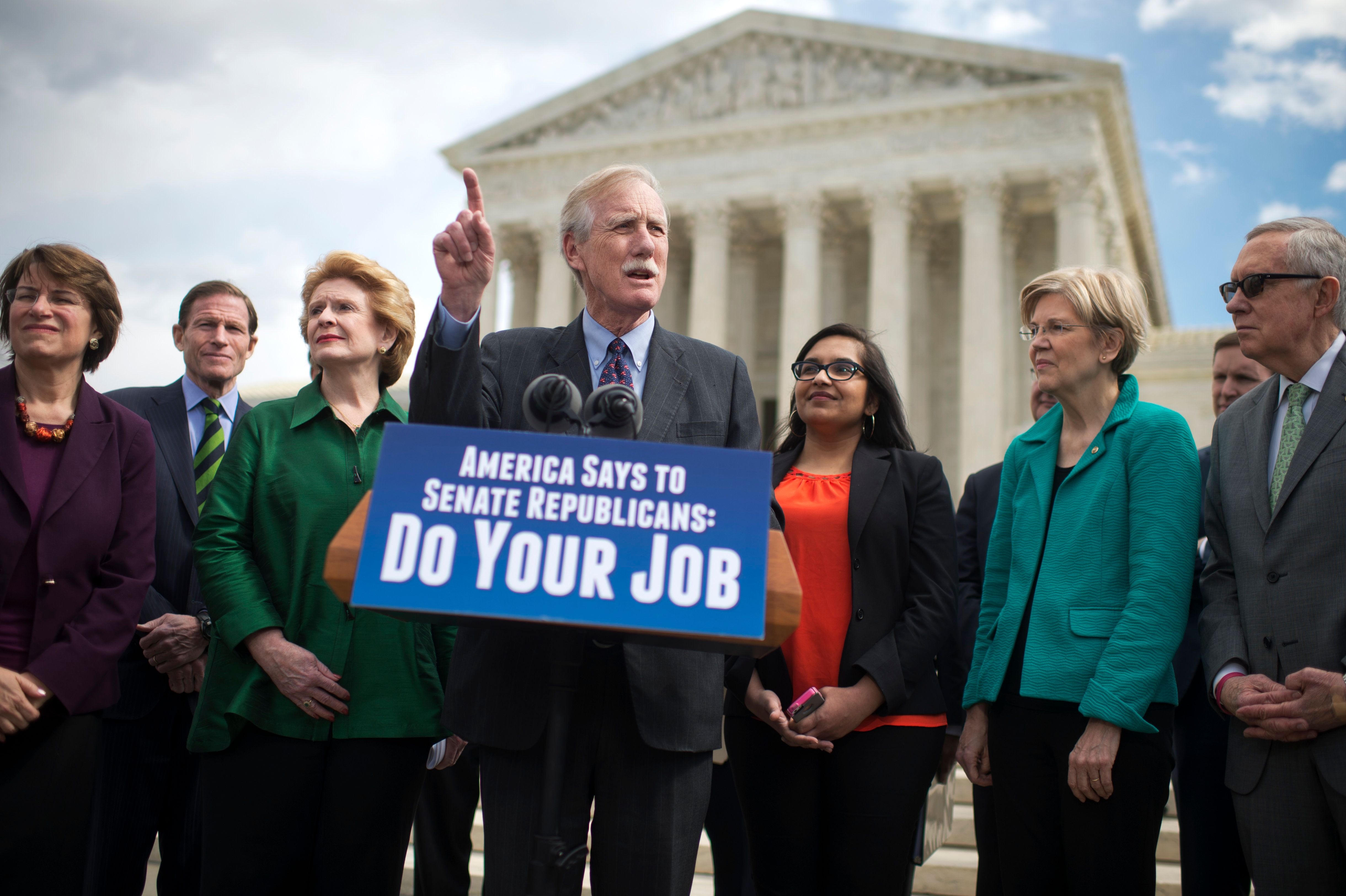 UNITED STATES - MARCH 17: From left, Sens. Amy Klobuchar, D-Minn., Richard Blumenthal, D-Conn., Debbie Stabenow, D-Mich., Angus King, I-Me., Dr. Manisha Sharma, Elizabeth Warren, D-Mass., and Senate Minority Leader Harry Reid, D-Nev., conduct a news conference at the Supreme Court to encourage a hearings and a vote on justice nominee Merrick Garland, March 17, 2016. (Photo By Tom Williams/CQ Roll Call)