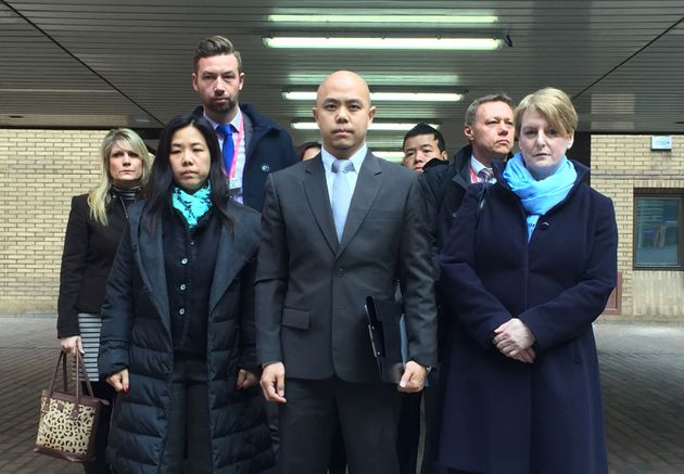 Stephanie Ho (front left) and Derek Ho (centre), sister and brother of beheading victim Samantha Ho,...