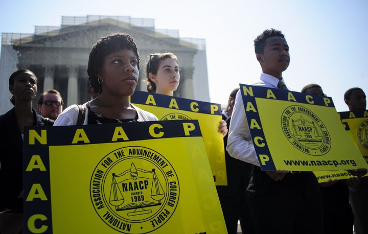 Jessica Pickens, 19, stands with fellow voting rights activists outside the U.S. Supreme Court in Washington, D.C., on June 25, 2013, the day the court ruled on the Voting Rights Act striking down portions of the law.