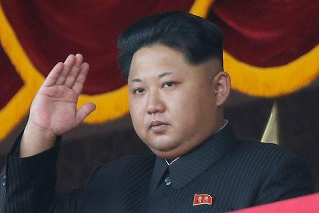 North Korean leader Kim Jong Un gestures as he watches a military parade in Pyongyang, North Korea. North...