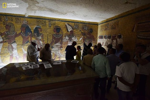Antiquities Minister Mamdouh Eldamaty, Egyptologist Nicholas Reeves and others examine the walls of King...