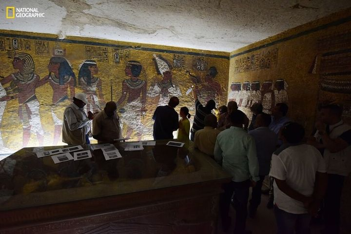 Antiquities Minister Mamdouh Eldamaty, Egyptologist Nicholas Reeves and others examine the walls of King Tut's tomb, looking