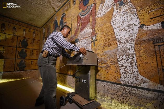 Radar specialist Hirokatsu Watanabe examines the walls of King Tut's tomb in an image provided by...