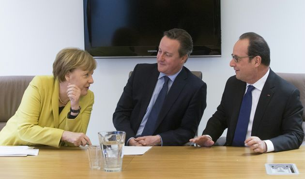 German Chancellor Angela Merkel talks with Britain Prime minister David Cameron and French President...