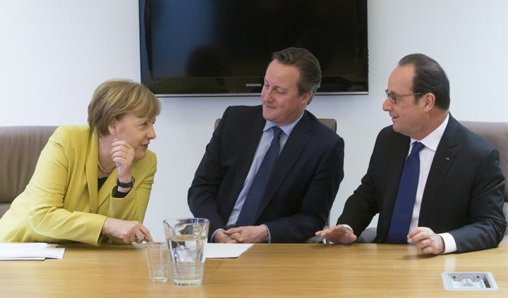 German Chancellor Angela Merkel talks with Britain Prime minister David Cameron and French President of Republic Francois Hol