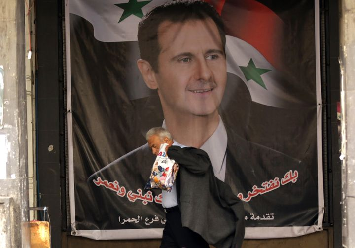 A poster of Bashar Assad in Damascus. Assad's regime cultivated and facilitated many of the jihadist forces that he now fight