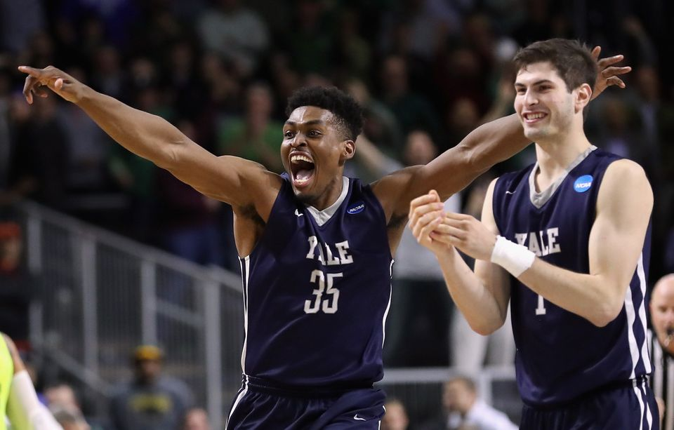 PROVIDENCE, RI - MARCH 17:  Brandon Sherrod #35 of the Yale Bulldogs and Anthony Dallier #1 celebrate defeating the Baylor Be