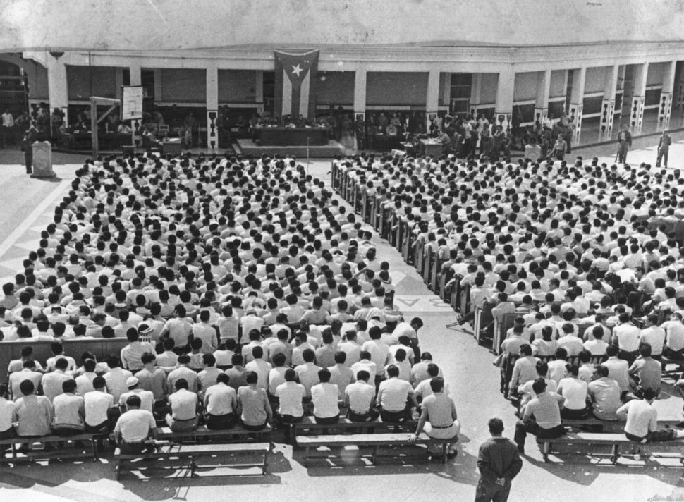 This April 1961 photo shows hundreds of CIA-trainedCuban exiles beingtried in a revolutionary court after the <a