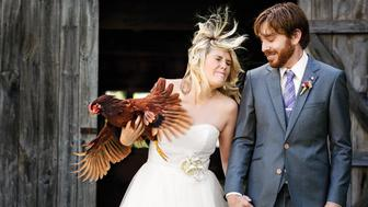 """We've had Nugget since she was a chick. For our pre-wedding photos, I had her nestled in my arms, but she started waving her wings around. I think she was pissed that we were using her as a 'chicken bouquet.' We both got drawings of her tattooed on our wrists last fall."""