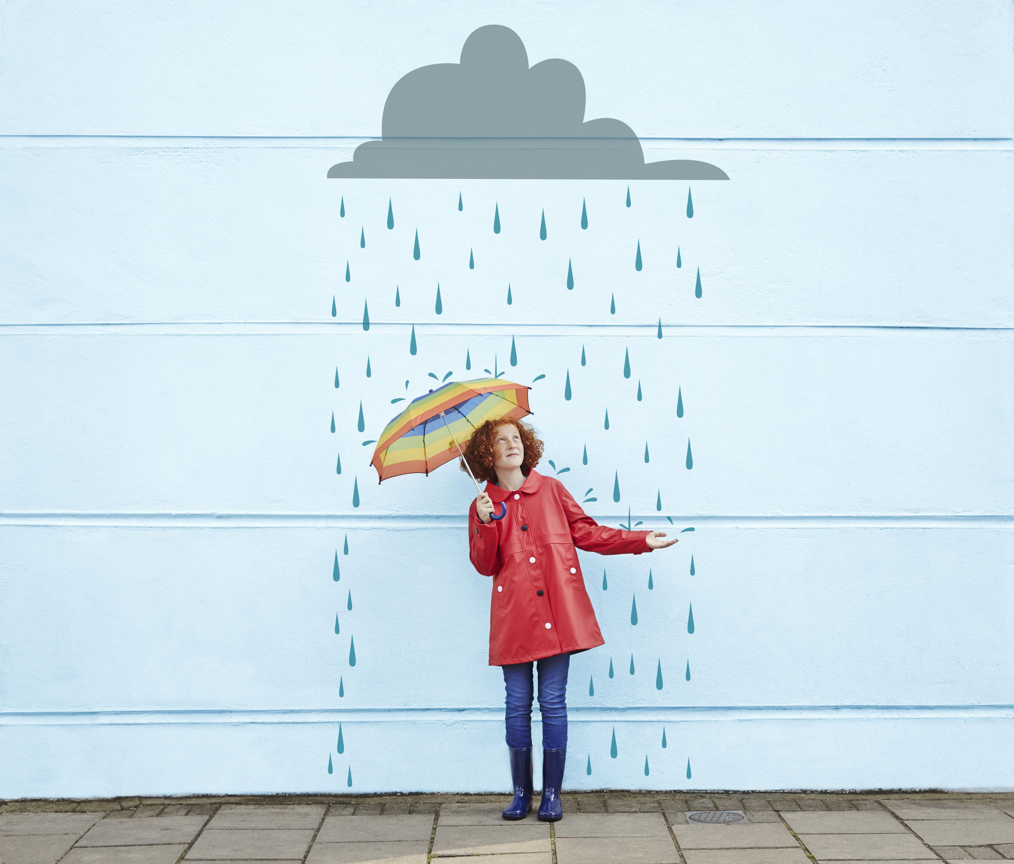 Girl holding umbrella with cartoon rain cloud