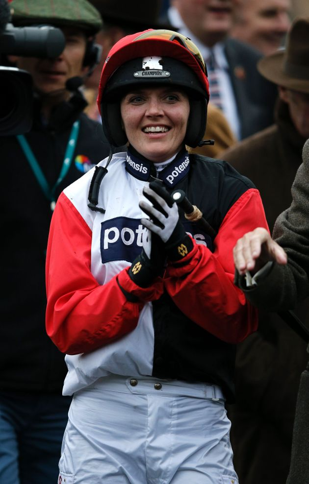Former British olympic cycling star Victoria Pendleton applauds the winner on