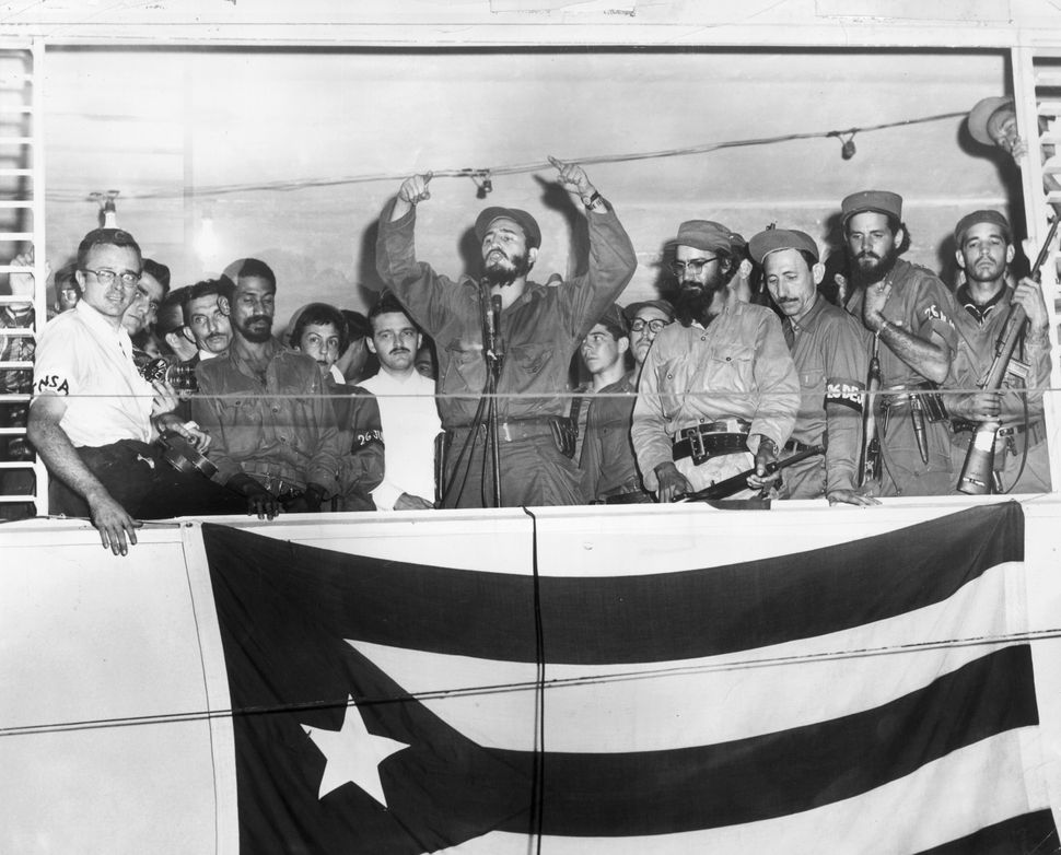 Fidel Castro and his supporters speak from a podium in Camaguey on Jan. 4, 1959, three days after Batista flees the island fo