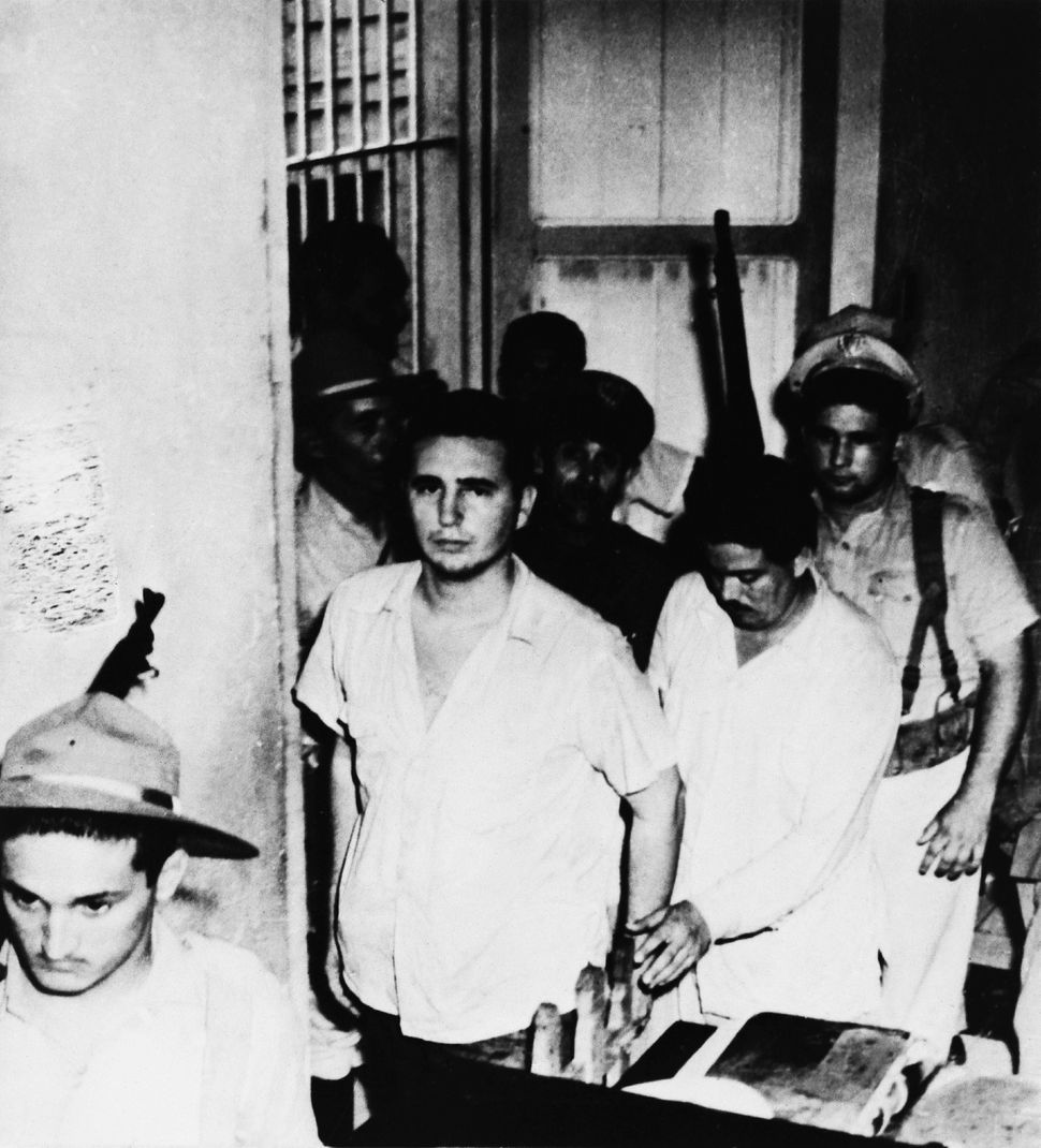 """Fidel Castro is captured as he heads for trial following the <a href=""""http://www.pbs.org/wgbh/amex/castro/peopleevents/e_monc"""