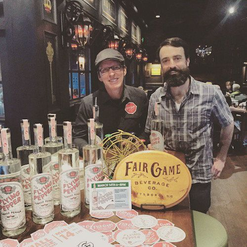 Kevin Bobal, left, and Chris Jude of Fair Game Beverage Co. in Pittsboro, North Carolina introduce Flying Pepper vodka at The Marshall Free House in Greensboro.