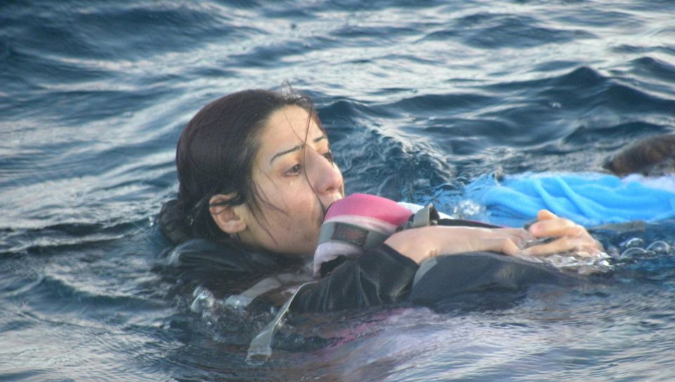 Rukhsan Muhammed, who used her suitcase to keep her 1-year-old son,Mirwan,from drowning....