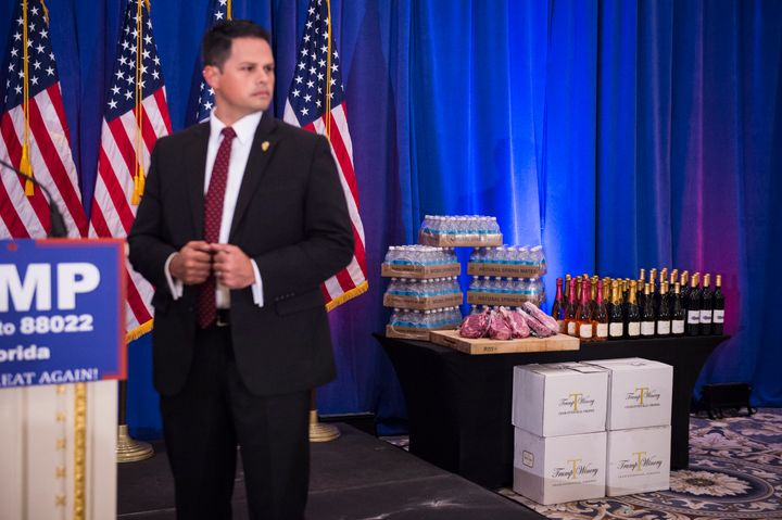 A display including Trump branded wine, champaign, water and steaks is seen before a campaign press conference event at the T