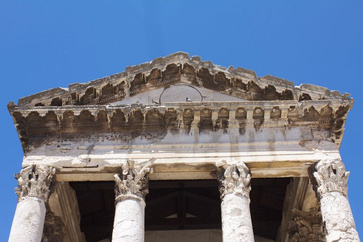 The fascade of the Temple of Augustus as it appears today.
