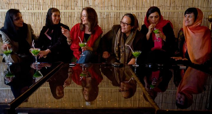 Afghan businesswomen, including Mina Sherzoy (far right), gather in 2009 to discuss new laws in that country.