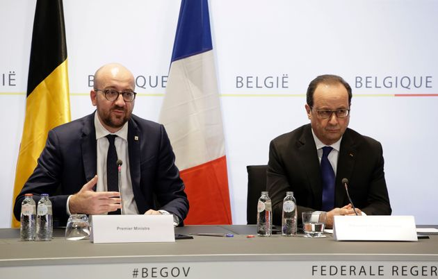 Michel (left) and Hollande (right) address
