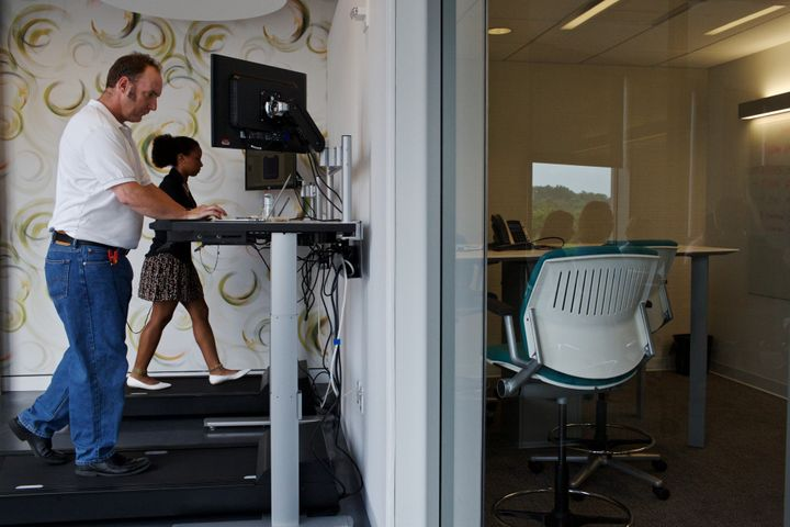 Workers use treadmill desks in Arlington, Virginia.