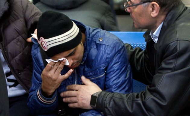 Relatives of the victims of the airplane crash mourn at the airport in