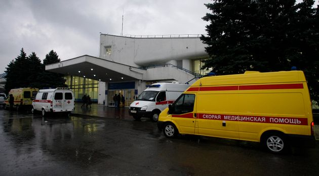 Ambulances are seen outside the airport entrance following the