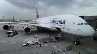 A Lufthansa Airbus A-380 aircraft waits for passengers at Frankfurt airport June 6, 2010. The plane, on its maiden flight, took the German football team to Johannesburg for the 2010 Football World Cup. AFP PHOTO / JOHN MACDOUGALL (Photo credit should read JOHN MACDOUGALL/AFP/Getty Images)