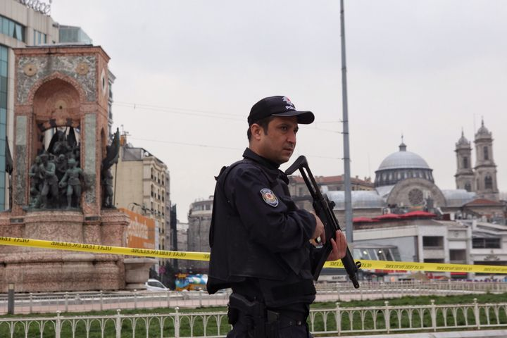 It was the fourth suicide attack in Turkey already this year. Pictured, a police officer guards Taksim square after Saturday'