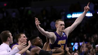 OKLAHOMA CITY, OK - MARCH 18:  Paul Jesperson #4 of the Northern Iowa Panthers celebrates with his teammates after hitting a half court three pointer at the buzzer to defeat the Texas Longhorns with a score of 75 to 72 during the first round of the 2016 NCAA Men's Basketball Tournament at Chesapeake Energy Arena on March 18, 2016 in Oklahoma City, Oklahoma.  (Photo by Ronald Martinez/Getty Images)