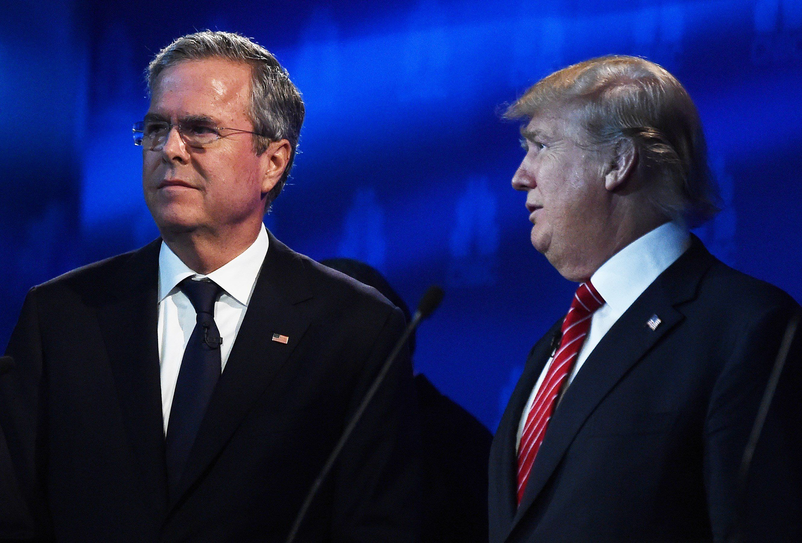 Republican Presidential hopefuls Donald Trump (R) and Jeb Bush look on during a break in the CNBC Republican Presidential Debate, October 28, 2015 at the Coors Event Center at the University of Colorado in Boulder, Colorado. AFP PHOTO/ ROBYN BECK        (Photo credit should read ROBYN BECK/AFP/Getty Images)