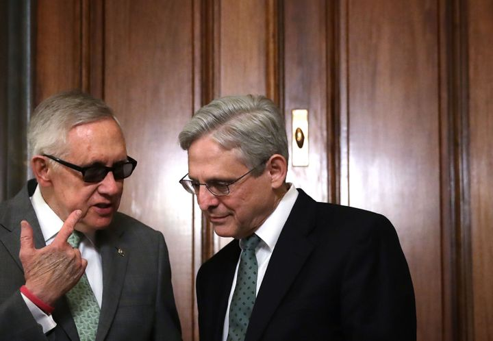 Merrick Garland (right), here with Senate Minority Leader Harry Reid (D-Nev.), will need all the advice he can get to convinc
